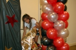 "Making a balloon column with silver metallic 36"" stars"