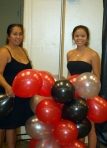 Shanna Badon Dellomes with Kimmie making a balloon column decoration